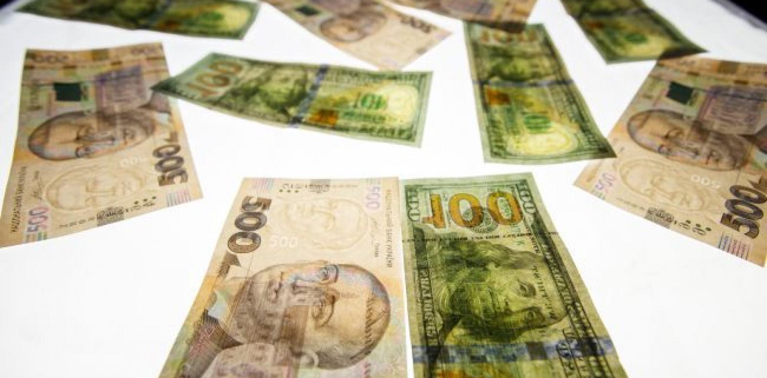 НБУ на 31 марта снизил официальный курс доллара